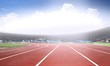 canvas print picture - Running track in a stadium under bright sunlight