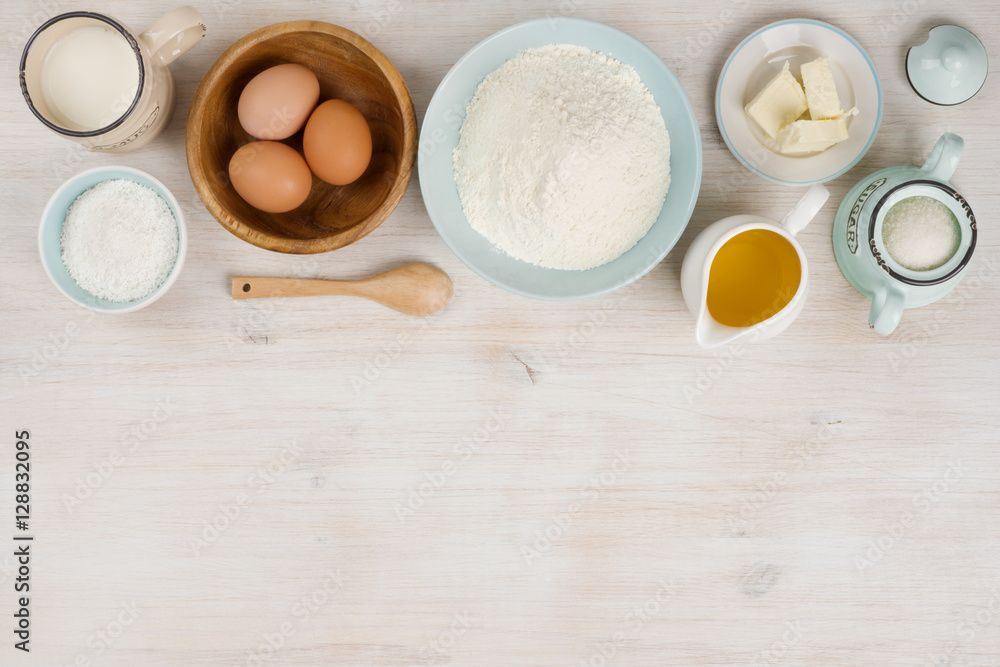 Fototapety, obrazy: Various bakery ingredients on wood textured table, view from above