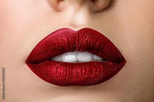 Close up view of beautiful woman lips with red matt lipstick Fototapeta