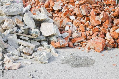 Fototapeta Concrete and brick rubble debris on construction site after a demolition