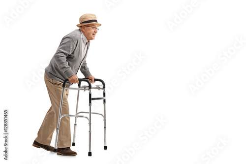 Photo  Senior walking with a walker
