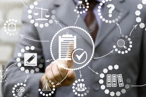 businessman presses compliance icon on virtual screen Wallpaper Mural