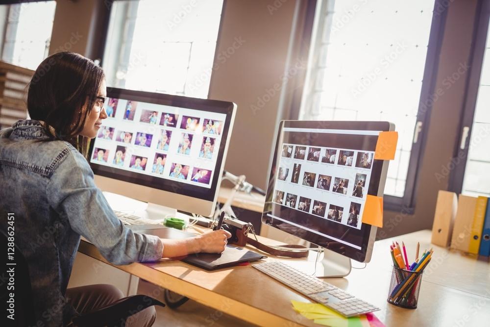 Fototapety, obrazy: Graphic designer using graphics tablet