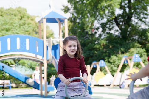 Fototapety, obrazy: Girl playing on   playground