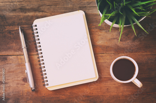 Fotografie, Obraz  open notebook with blank pages next to cup of coffee