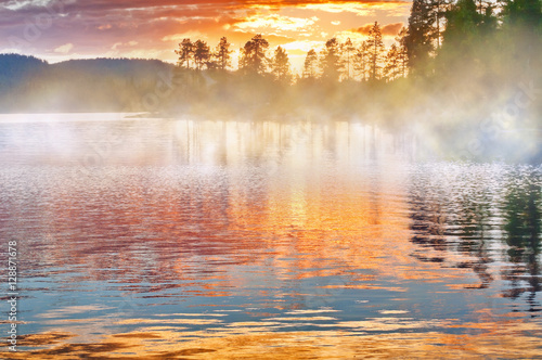 Fototapety, obrazy: The lake with floating fog at sunset, Finland.