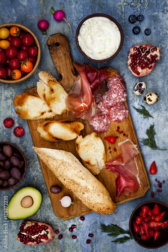 Brushetta or authentic traditional spanish tapas set for lunch table. Sharing antipasti on party or & Brushetta or authentic traditional spanish tapas set for lunch table ...