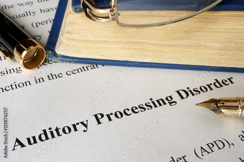 Photo Auditory processing disorder APD on a sheet on an office table.