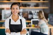 canvas print picture - Portrait of smiling waitress standing with arms crossed