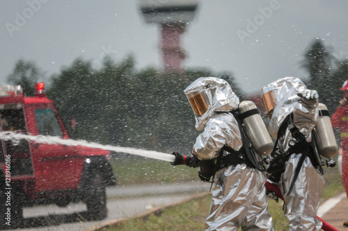 Fotografie, Obraz  Fire departments & emergency response teams suited up with PPE t