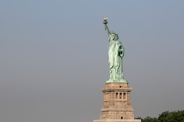 Fototapeta na wymiar Majestic iconic lady liberty statue of liberty in New York harbor welcoming new arrivals