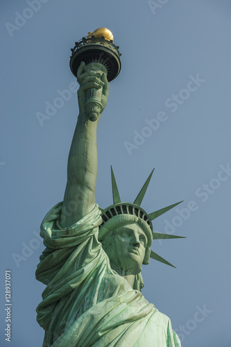 Fototapeta Majestic iconic lady liberty statue of liberty in New York harbor welcoming new arrivals