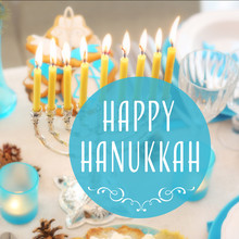 Menorah With Candles On Table Served For Hanukkah Celebration. Text HAPPY HANUKKAH