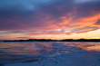 Winter landscape with color ice, sunset