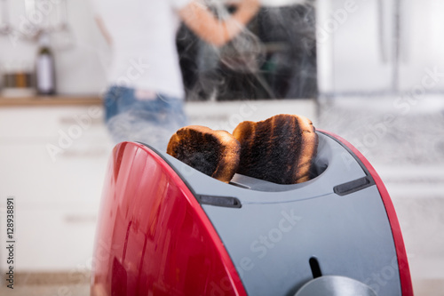Burnt Toast Coming Out Of Toaster
