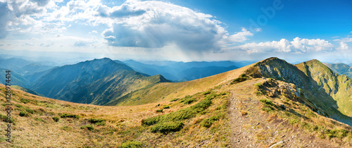 Canvas Prints Hill Landscape with blue mountains