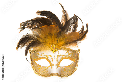 Pretty venetian golden carnival mask with feathers isolated on a white background