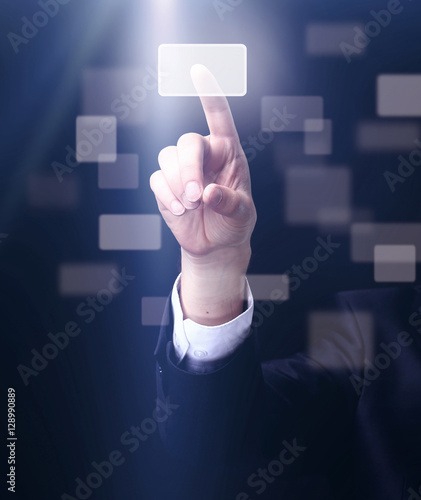 Photo  business man pressing a touchscreen button on dark background