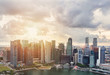 Business city urban skyline sunset. Singapore skyscrapers in downtown, cloud sky, sunlight