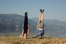 Couple Of Young Yogis Stand On...
