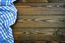Blue Checkered Napkin On Wooden Table