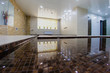 Interior of sauna with a swimming pool and a place to relax