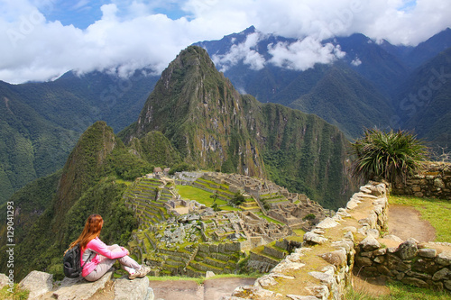 Spoed Foto op Canvas Zuid-Amerika land Woman enjoying the view of Machu Picchu citadel in Peru