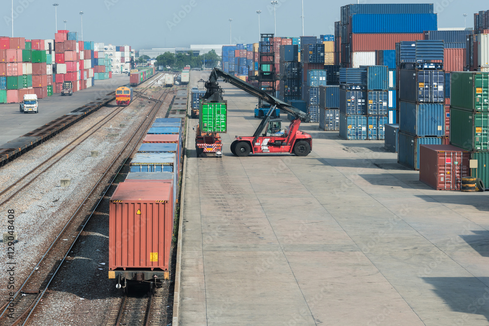 Fototapeta Cargo train platform with freight train container at depot in po