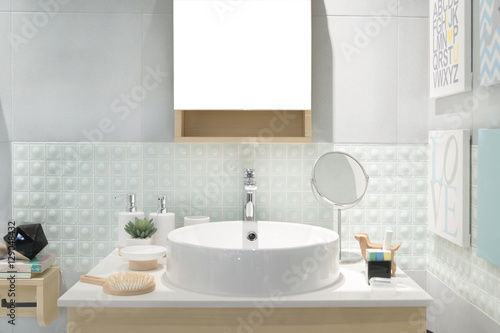 Valokuva  Interior of bathroom with sink basin faucet and mirror. Modern d