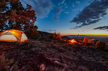 Tent Camping In Sedona Arizona By A Campfire Over The City Dusk