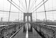 Brooklyn Bridge on stormy rain day. In black and white.