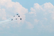 Six Blue Angels Jets In Formation Against Clouds