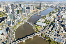 Brisbane CBD Cityscape And South Bank With Adjoining Bridges Over The River, View From Above.