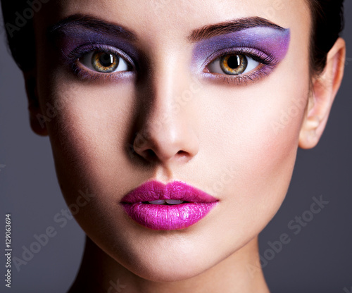 Foto op Plexiglas Beauty Beautiful girl's face closeup with purple eye make-up. fashion m