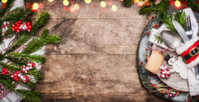 Christmas Table Place Setting With Festive Decor, Plate, Cutlery , Handmade Snowman And Blank Tag On Rustic Wooden Background, Top View, Banner