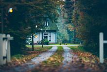 House In Autumn Forest With Driveway At Dusk. Exel. Achterhoek. Gelderland.