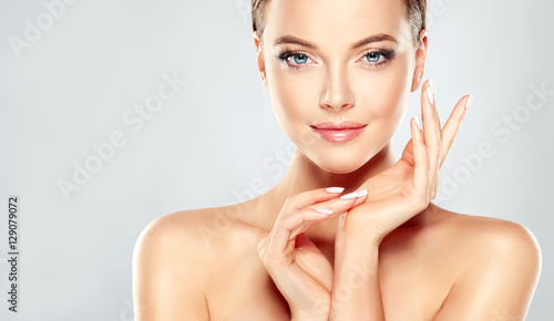 Beautiful Young Woman with Clean Fresh Skin touch own face Canvas Print