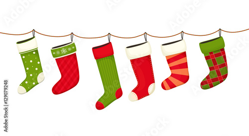 Fototapeta Christmas stockings. Hanging  New year decorations for gifts.