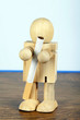 Smoking concept with wooden man holding a cigarette