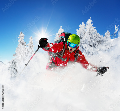 Freeride skier on piste running downhill Canvas Print