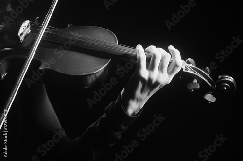 Foto auf Leinwand Musik Violin player violinist hands playing musical instruments
