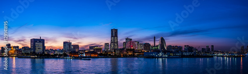 Canvas Prints Japan Wide panorama of Yokohama Minato Mirai 21 seaside urban area in Japan at dusk