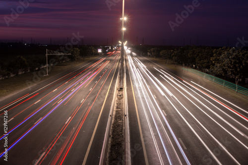 Tuinposter Nacht snelweg Speed Traffic at light trails on motorway highway at night,backg