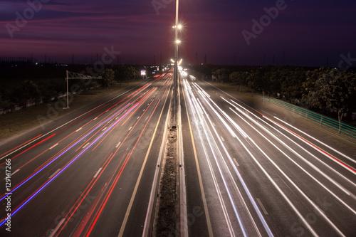 In de dag Nacht snelweg Speed Traffic at light trails on motorway highway at night,backg