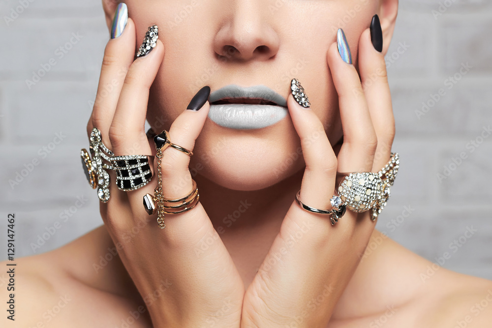 Fototapeta woman's hands with jewelry rings.close-up beauty and fashion girl, make-up and manicure