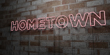 HOMETOWN - Glowing Neon Sign On Stonework Wall - 3D Rendered Royalty Free Stock Illustration.  Can Be Used For Online Banner Ads And Direct Mailers..