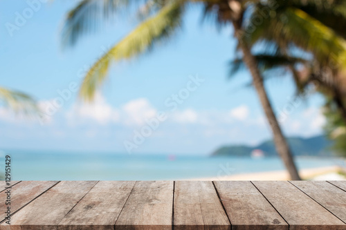 Foto auf Gartenposter Strand Wood table top and blurred summer beach and sky background. - can used for display or montage your products.