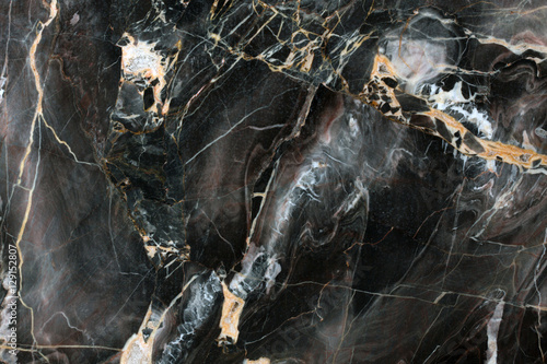 Photo sur Aluminium Marbre Mulicolored dark natural marble.