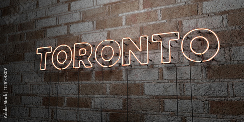 Photo  TORONTO - Glowing Neon Sign on stonework wall - 3D rendered royalty free stock illustration