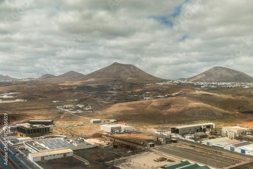 Recess Fitting Gray industrial buildings in Lanzarote valley, aerial photo
